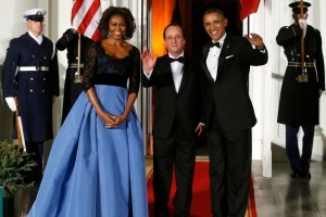 Obama and his wife Michelle greet Hollande as he arrives for a State Dinner in his honor at the White House in Washington