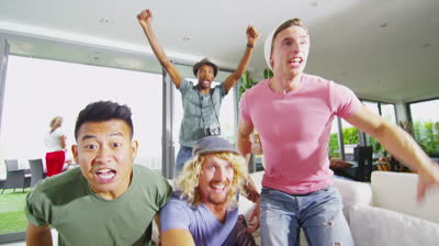 stock-footage-happy-group-of-male-friends-watching-sports-on-tv-and-cheering-on-their-team-in-slow-motion