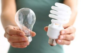 woman-holding-light-bulbs