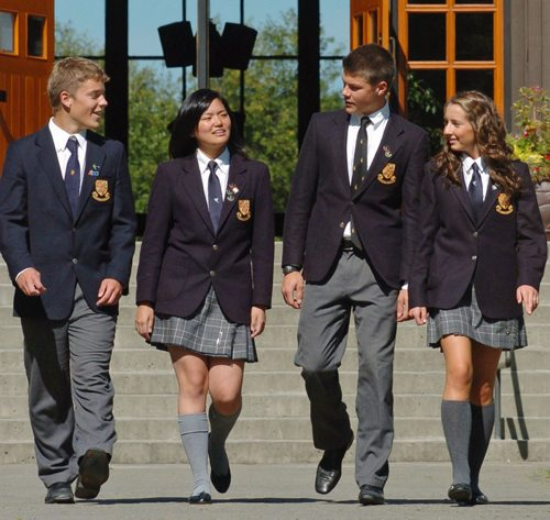Shawnigan Lake, BC- Spet 13/08- - UNIFORMS - Shawnigan Lake School students, from left, Owen Samuel, 16 years old, Katherine Lin, 17 years,  David Basche, 18 years and  Maddie McLeod, 17 years, all grade 12 students at the Vancouver Island private school, chat after lunch on the campus. For Private School Supplement on uniforms. Photograph by Diana Nethercott